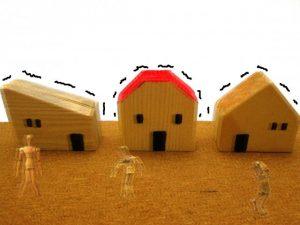 地震で揺れる住宅